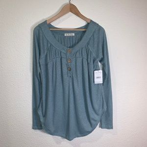 FREE PEOPLE WE THE FREE MUST HAVE HENLEY TOP